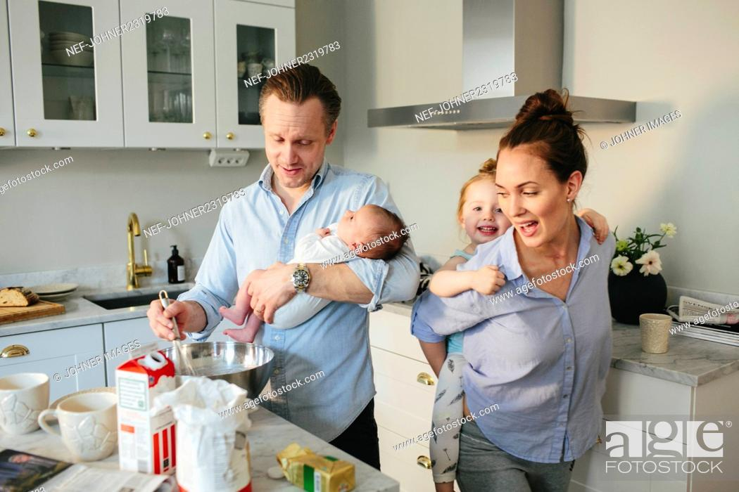 Stock Photo: Family in kitchen.