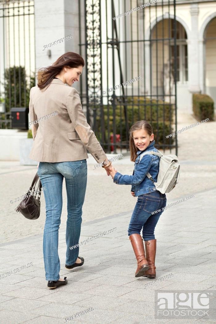 Stock Photo: Girl with her mother walking to school.