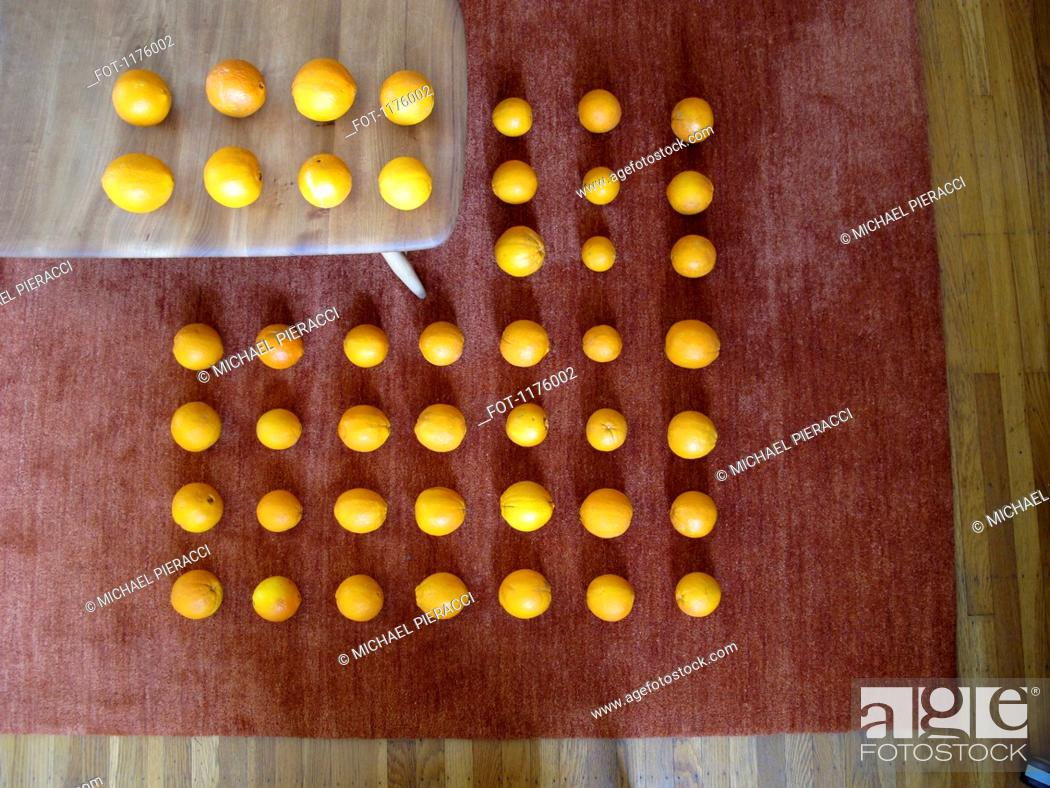 Stock Photo: Forced perspective of rows of tangerines.
