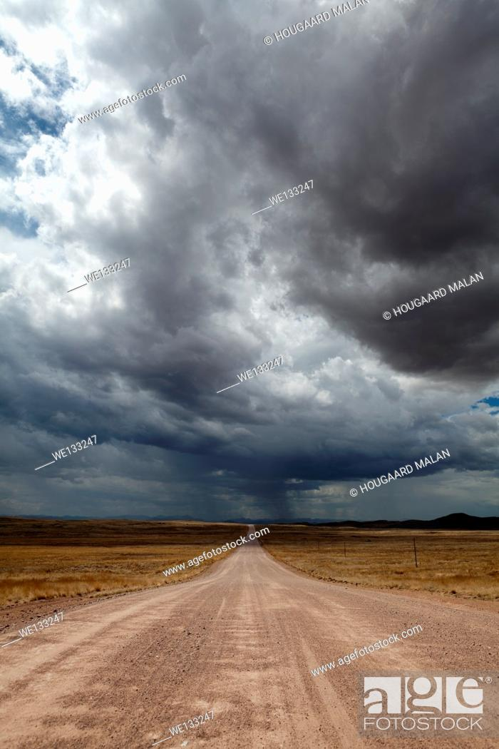 Stock Photo: Landscape photo of Namibia's C14 near Solitaire under stormy summer skies. Namibia.