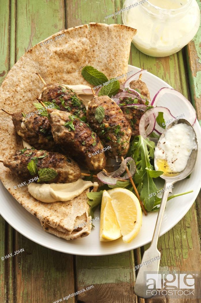Stock Photo: Lamb and pork kebabs with garlic yoghurt.