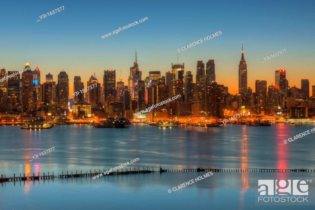 Stock Photo: The Manhattan skyline in New York City during morning twilight as viewed over the Hudson River looking east from New Jersey.