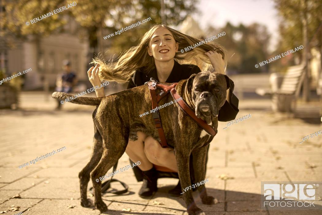Stock Photo: woman with dog. In Sauerlach, Munich, Bavaria, Germany.