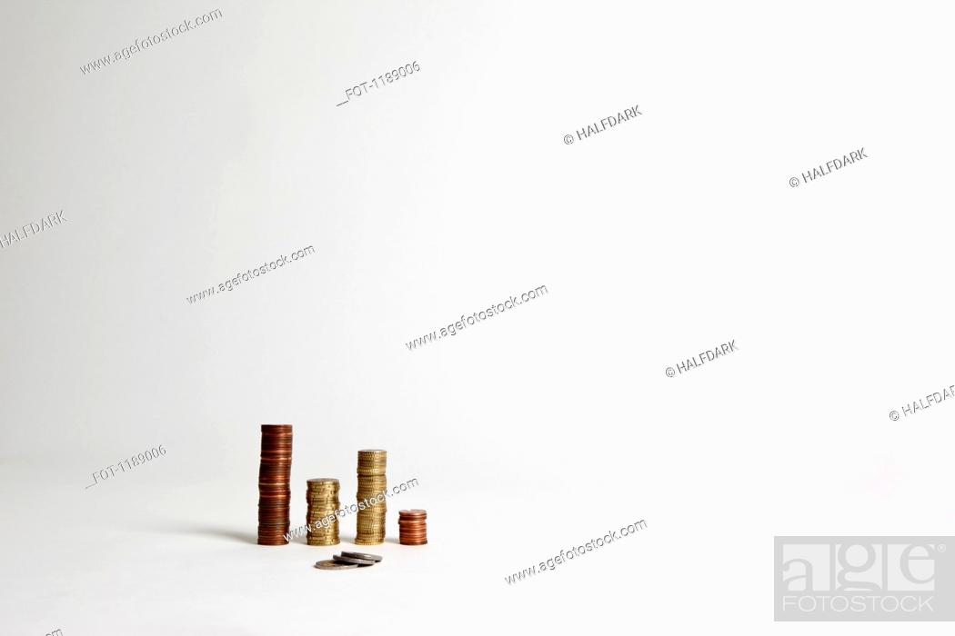 Stock Photo: A small pile of European Unions coins in front of several neat stacks of coins.