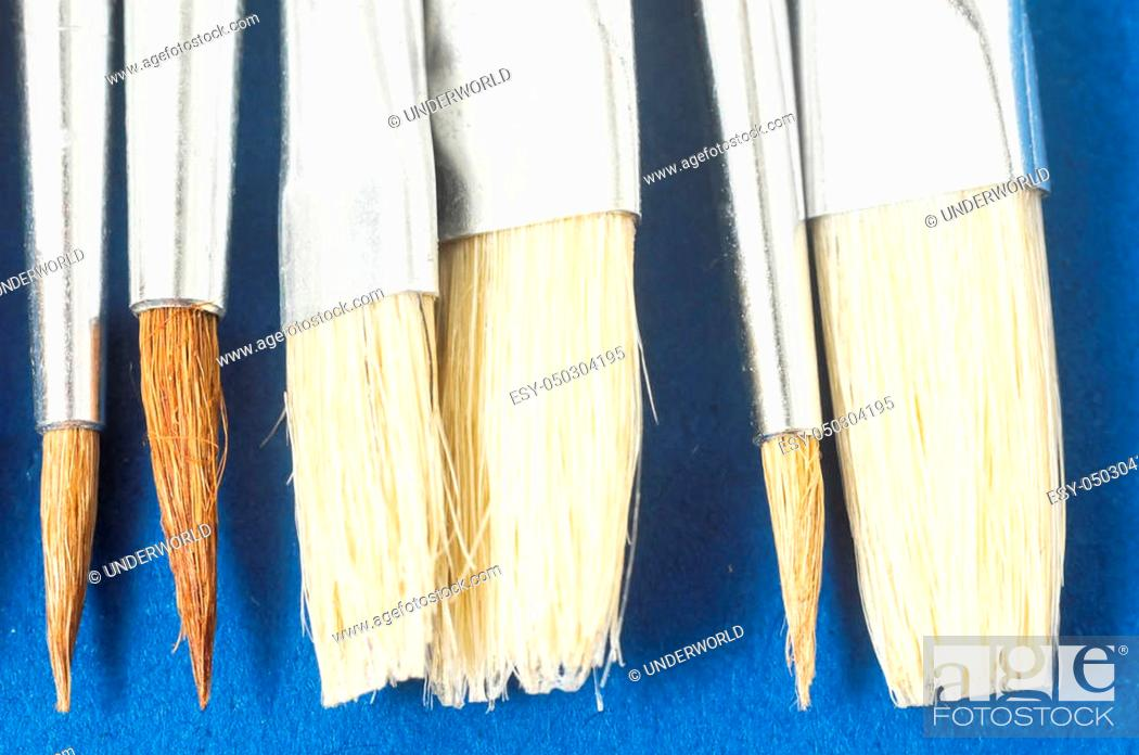 Photo de stock: New Wooden Different Paintbrush Set Texture over a Colored Background.