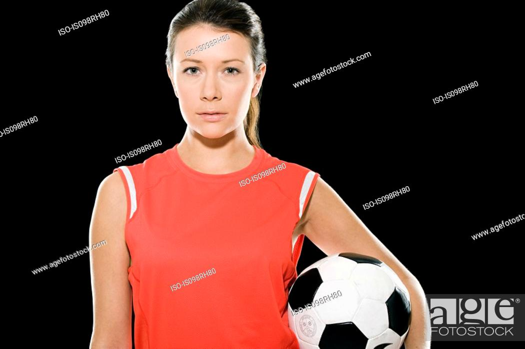 Stock Photo: Female footballer holding a football.