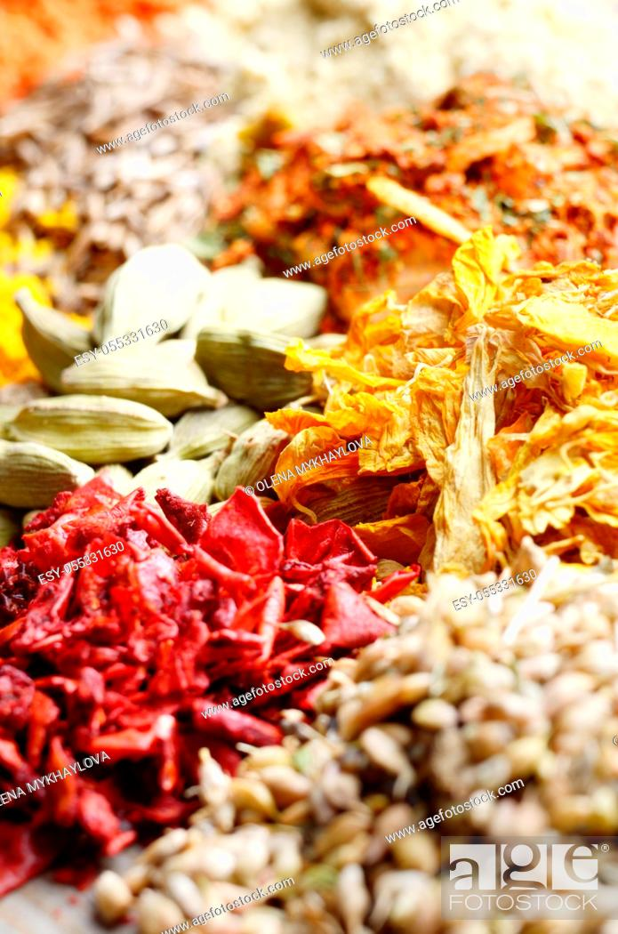Stock Photo: Assorted spices and dry herbs on wooden background.