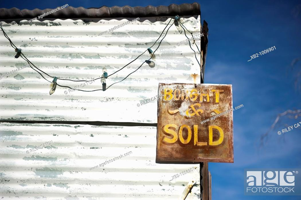 Stock Photo: Route 66, Arizona - An antique sign on an abandon building along the road.
