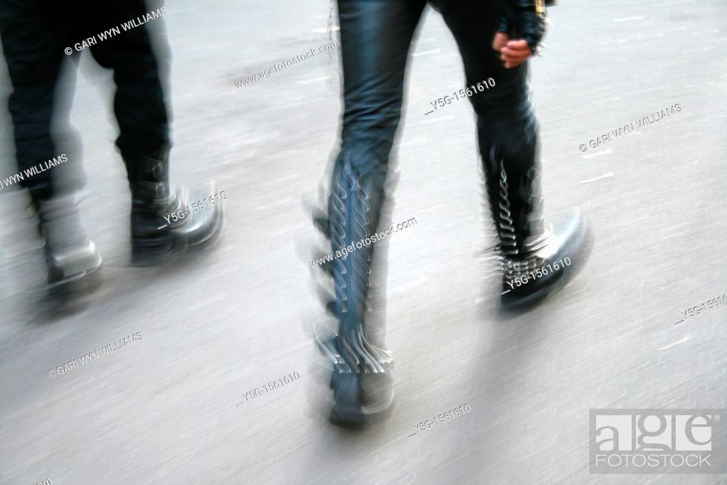 Stock Photo: people wearing leather boots running.