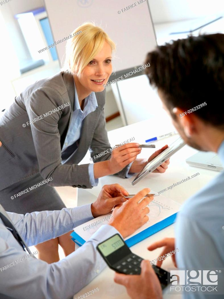Stock Photo: Executive woman making business presentation.