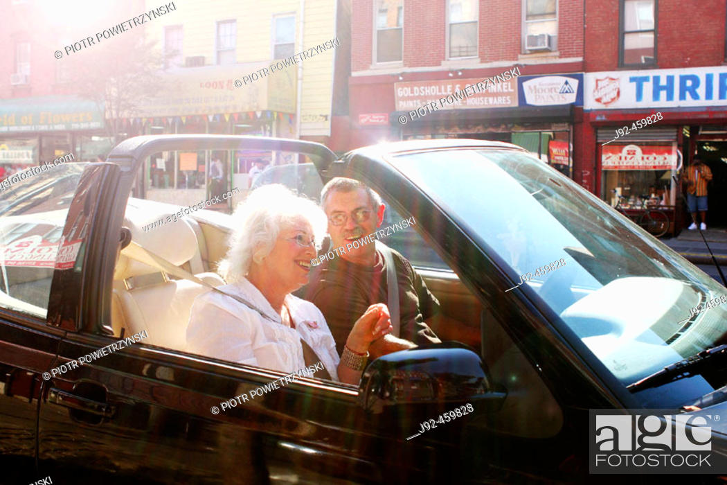 Stock Photo: Couple relaxing in convertible car, Greenwich Village,  New York City.
