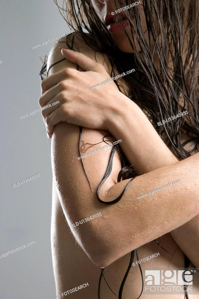 Stock Photo: Nude woman with crossed arms.
