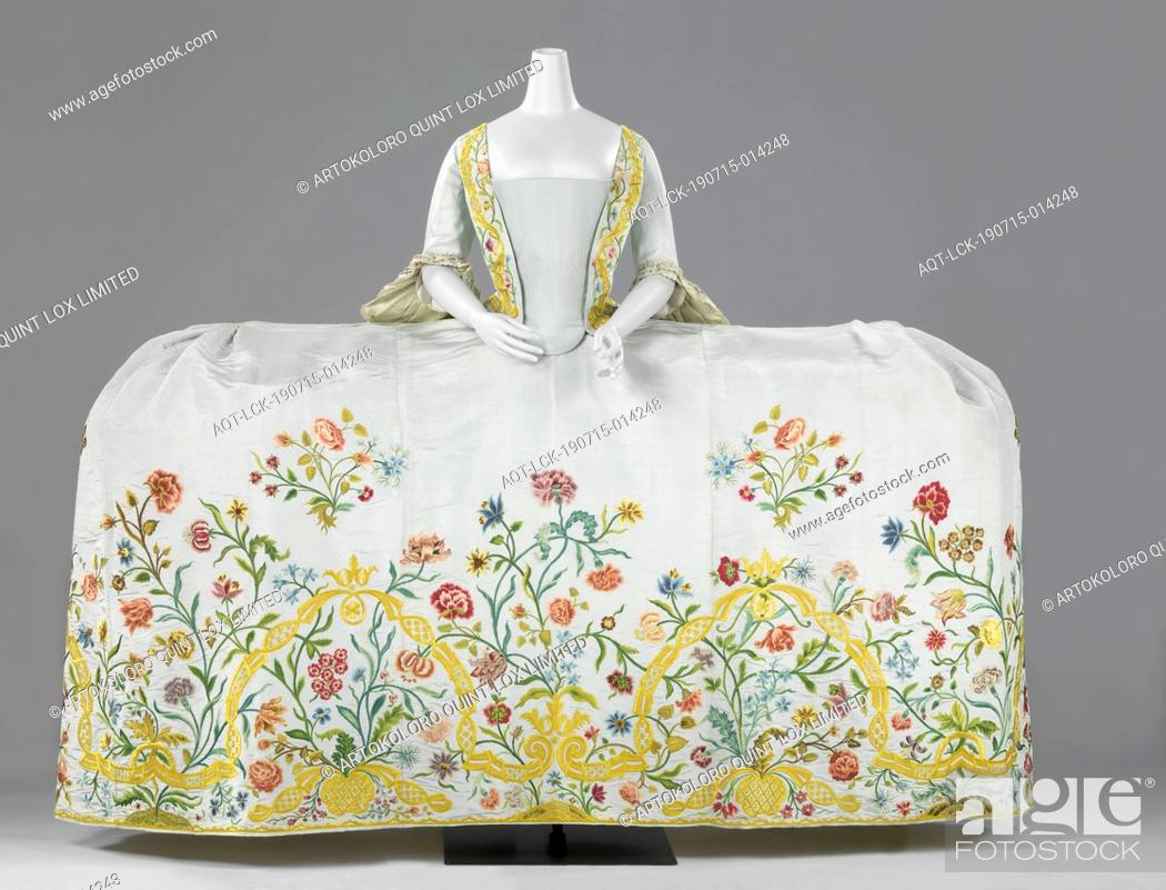 Stock Photo: Dress (Mantua) with Train Wedding gown made of light blue ripped silk embroidered with a floral motif in multicolored silk, consisting of a body with 'tail'.