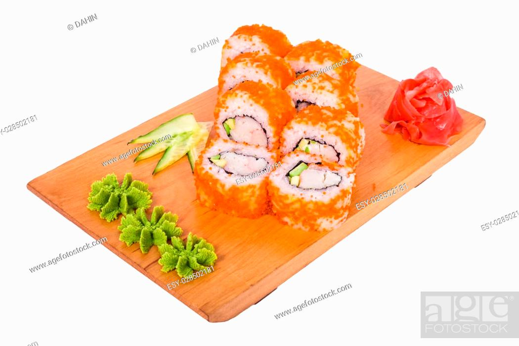 Stock Photo: 8 delicious sushi with red caviar and wasabi on a wooden tray.