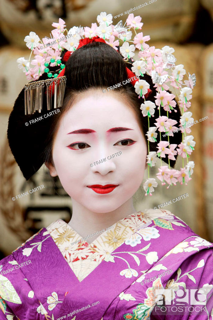Stock Photo: Geisha in traditional make-up and wearing a kimono in the Gion district of Kyoto, Japan.