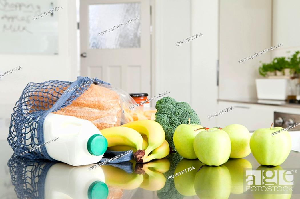 Stock Photo: Groceries on kitchen counter.