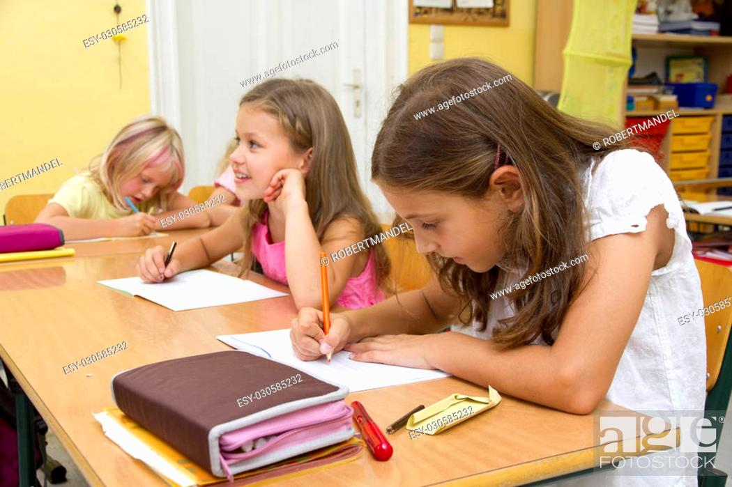 Stock Photo: Children learning in a classroom.