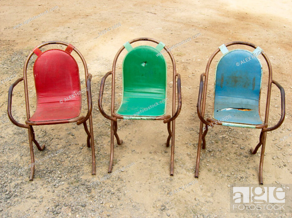 Stock Photo: Colourful old outdoor chairs.