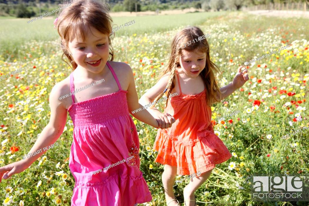 Stock Photo: Two little girls in meadow.
