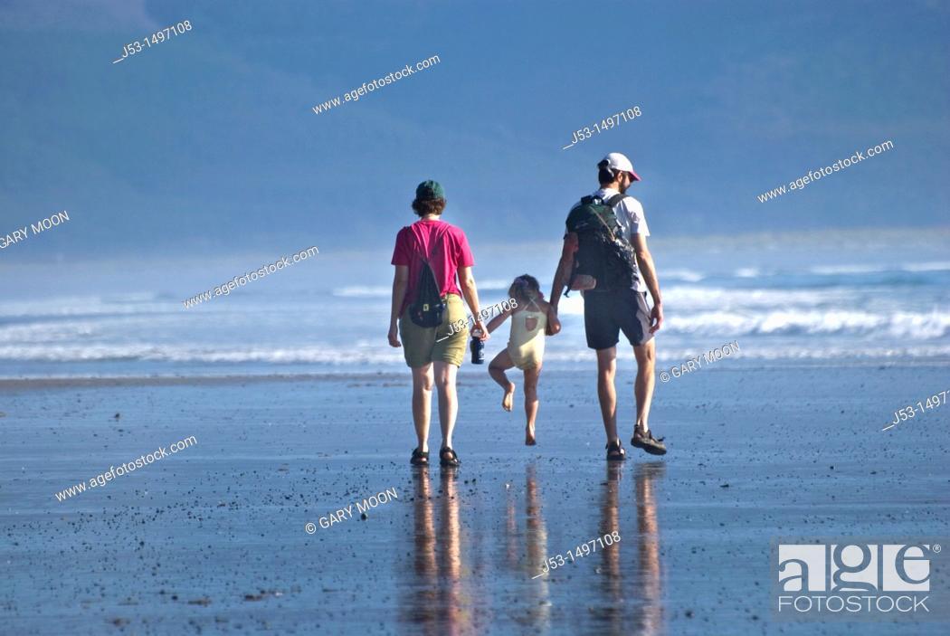 Stock Photo: Family enjoying a summer afternoon at an Oregon beach.