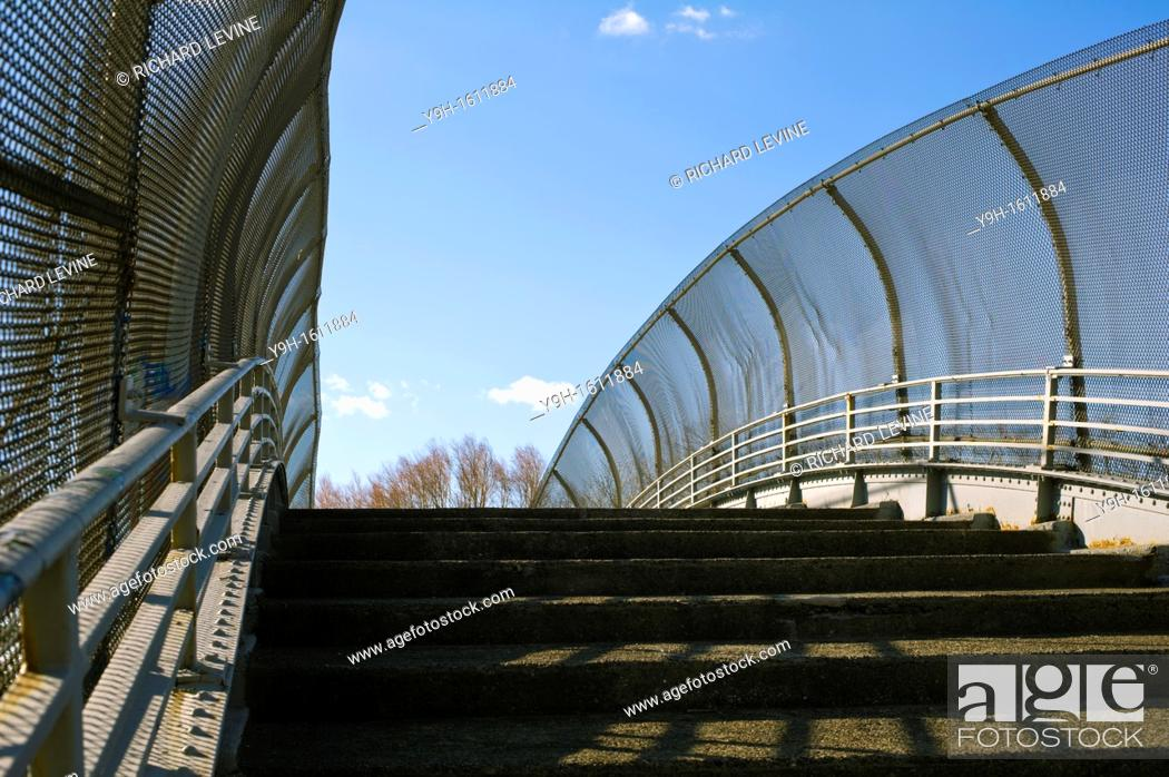 Stock Photo: A footbridge crossing over a highway in Brooklyn in New York.