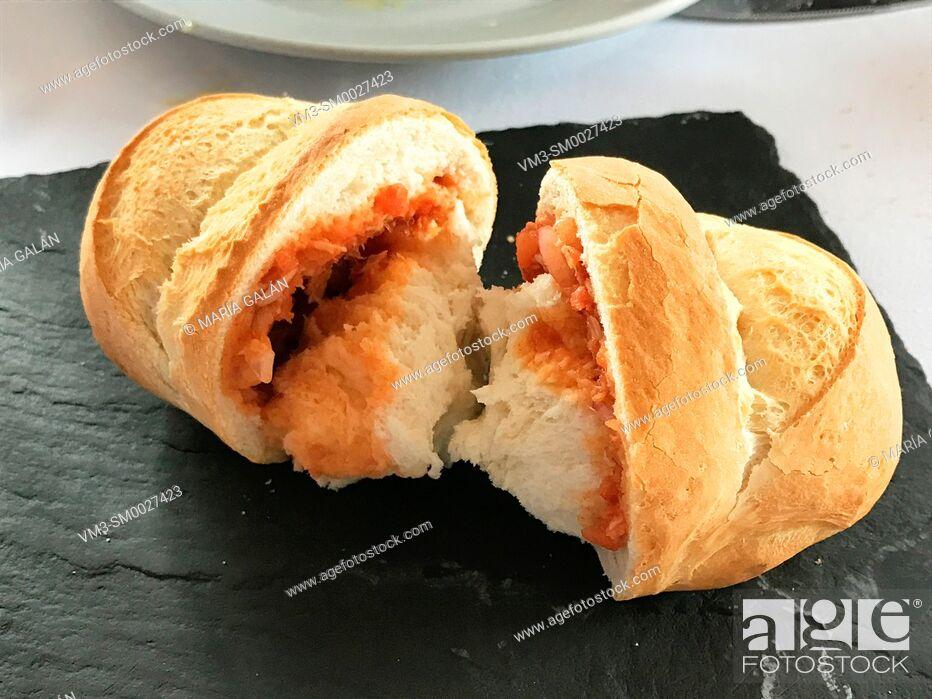 Stock Photo: Pozas: traditional bread filled with tomato and tuna, typical from Colmenar de Oreja, Comunidad de Madrid, Spain.
