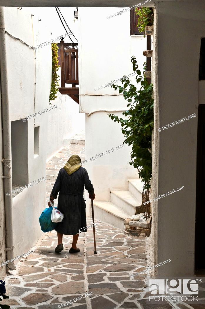 Stock Photo: Narrow whitwashed allyway in the Old town of Naxos, Naxos island, Cyclades, Greece.