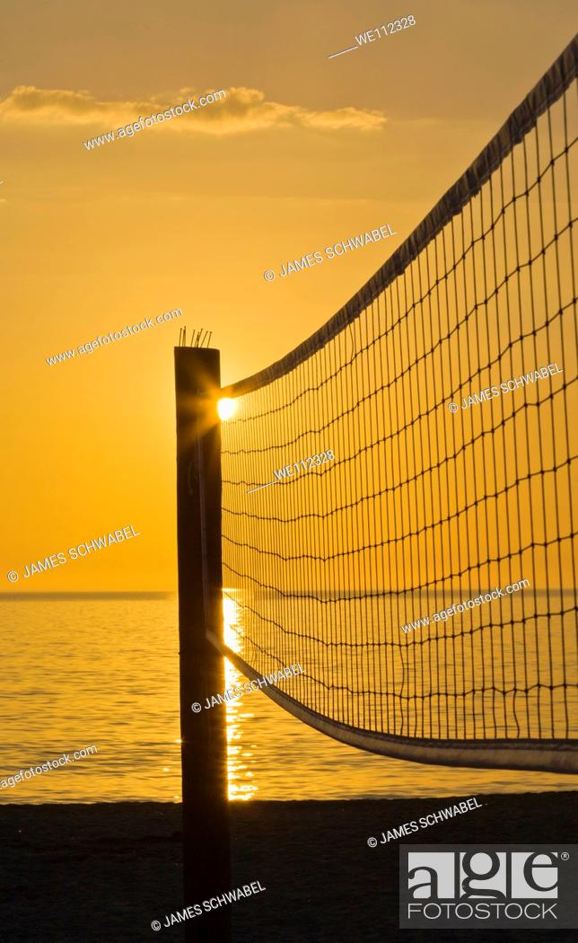Stock Photo: Volleyball net silhouetted aganist sunset sky on Venice Beach Florida.