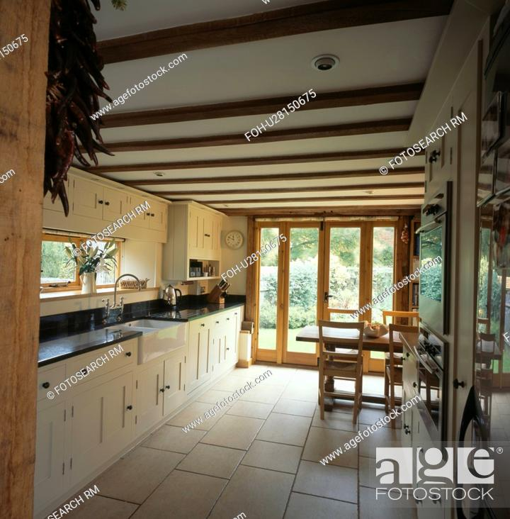 Cream ceramic floor tiles in country kitchen with cream ...
