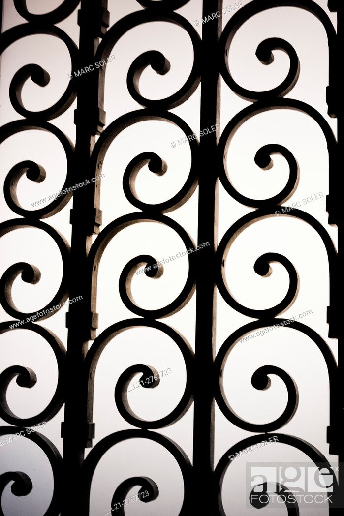 Stock Photo: Wrought iron spirals, grid.