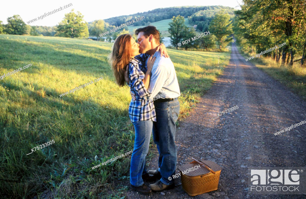 Stock Photo: Kissing on a country road.