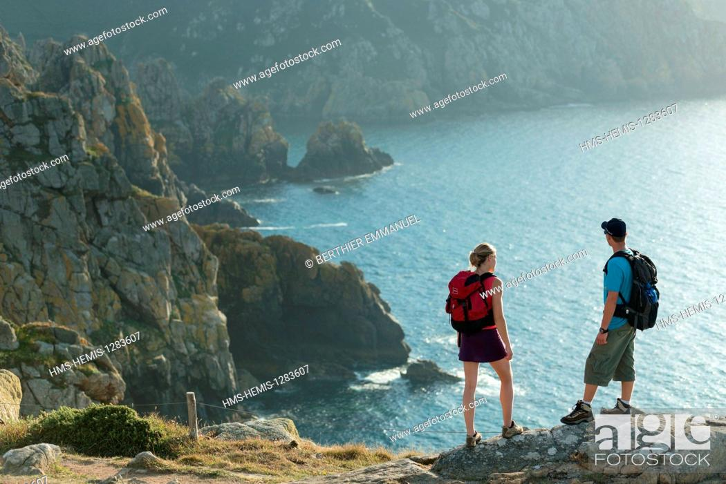 Stock Photo: France, Finistere, Goulien, hiking on the GR34 along the cliffs of the Nature Reserve Cap Sizun.