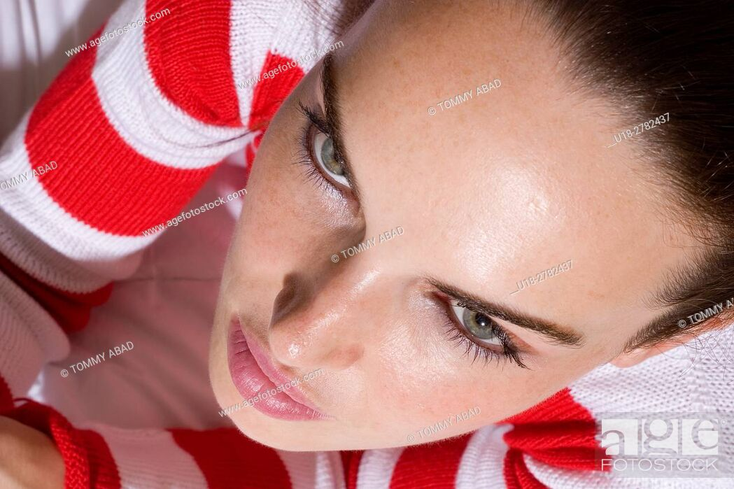 Stock Photo: a woman with green eyes wearing a christmas white and red outfit shot from above.