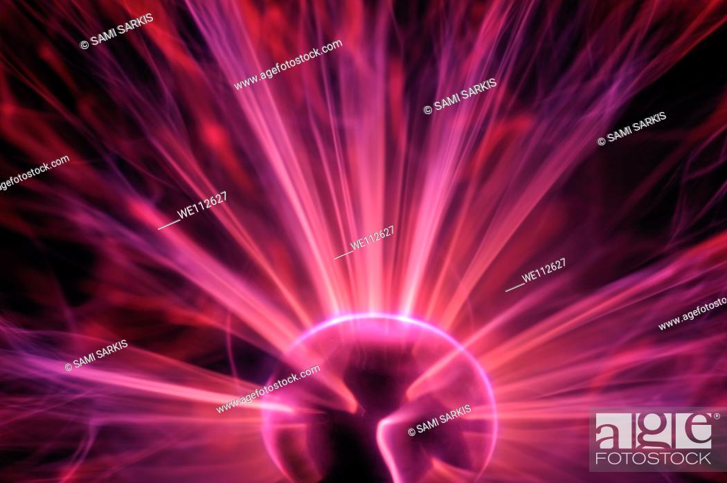 Stock Photo: Plasma ball making electric discharges from a central electrode long exposure.