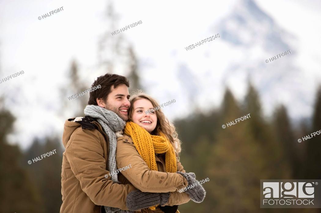 Photo de stock: Portrait of happy young couple in winter landscape.