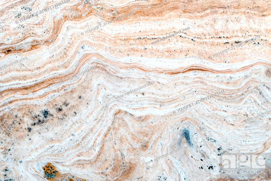 Stock Photo: Smooth surface texture of stone, White beige or ecru color striped wave pattern of marble, Strong structure durable nature of rock for abstract background.