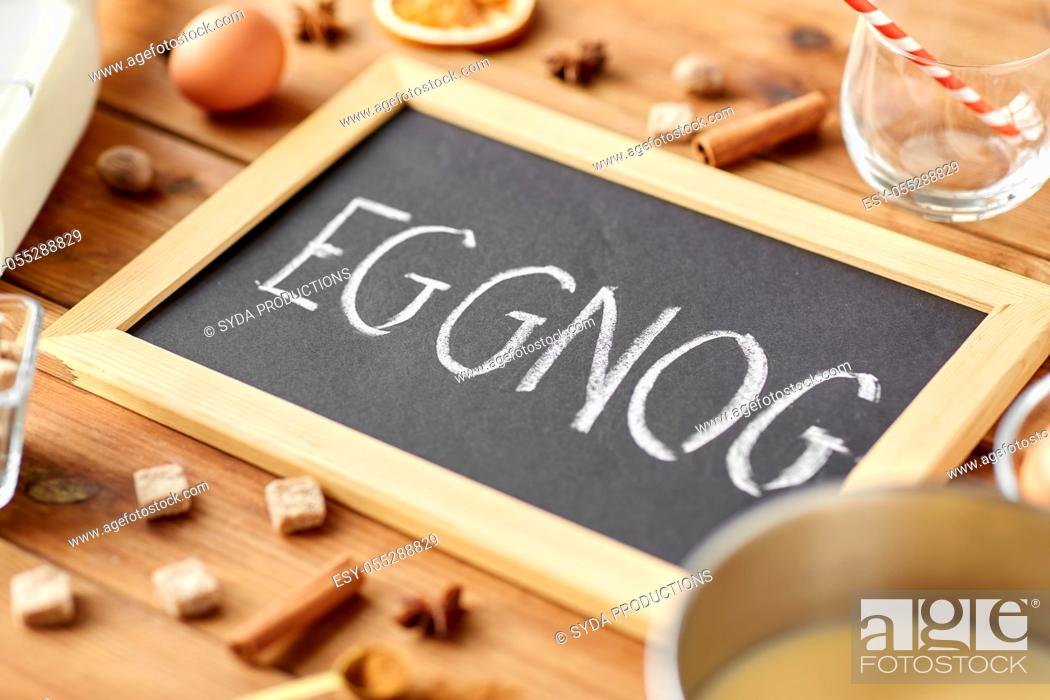 Stock Photo: eggnog word on chalkboard, ingredients and spices.