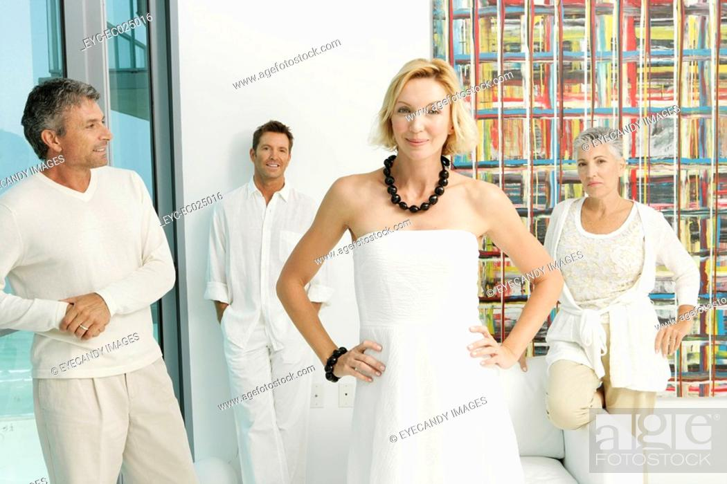 Stock Photo: Group of four mature adults all dressed in white.