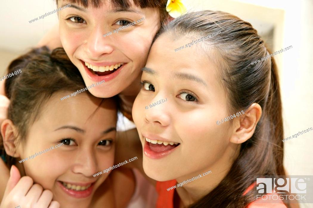 Stock Photo: Close-up of young women smiling.