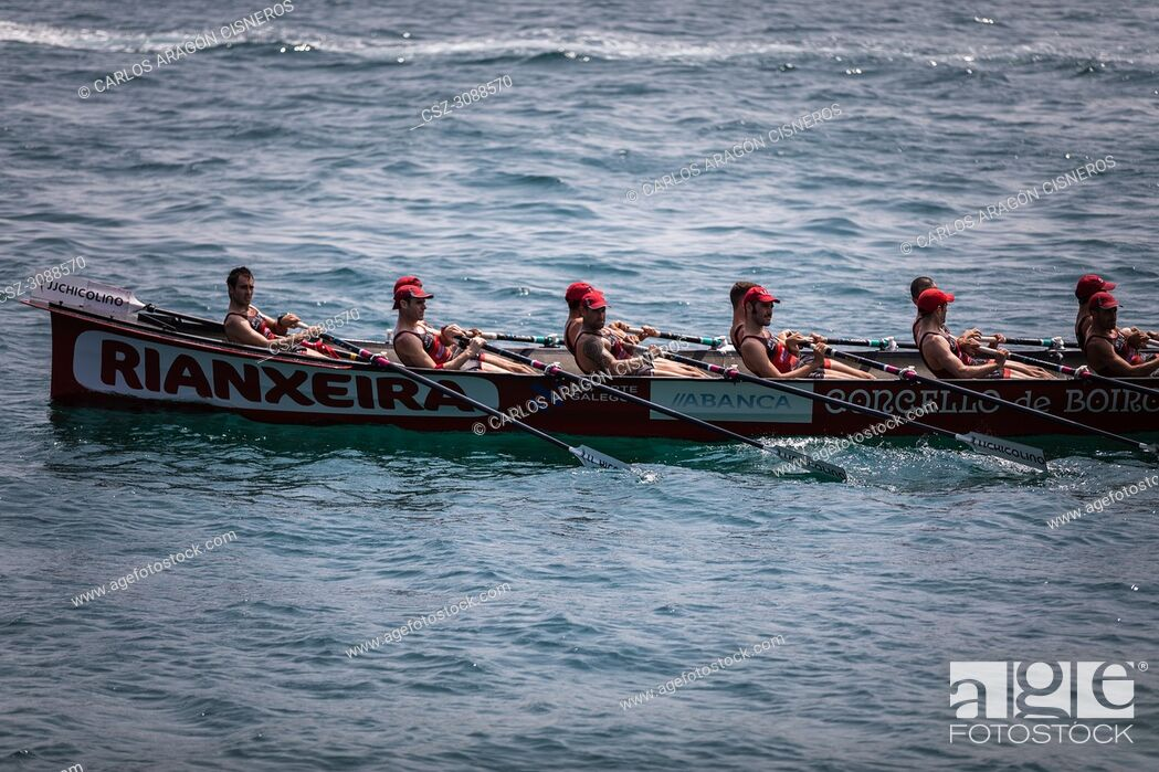 Stock Photo: CASTRO URDIALES, SPAIN - JULY 15, 2018: Competition of boats, regata of trainera, Cabo boat in action in the VI Bandera CaixaBank competition.