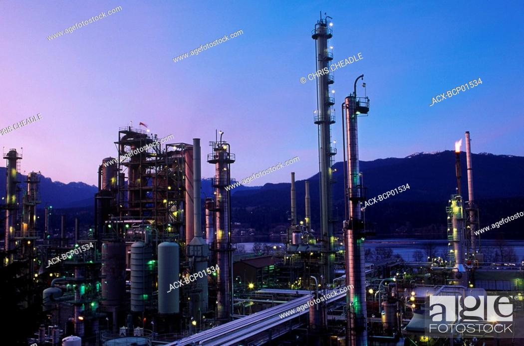 Stock Photo: Oil refinery in Burnaby, North Shore mountains beyond, Vancouver, British Columbia, Canada.