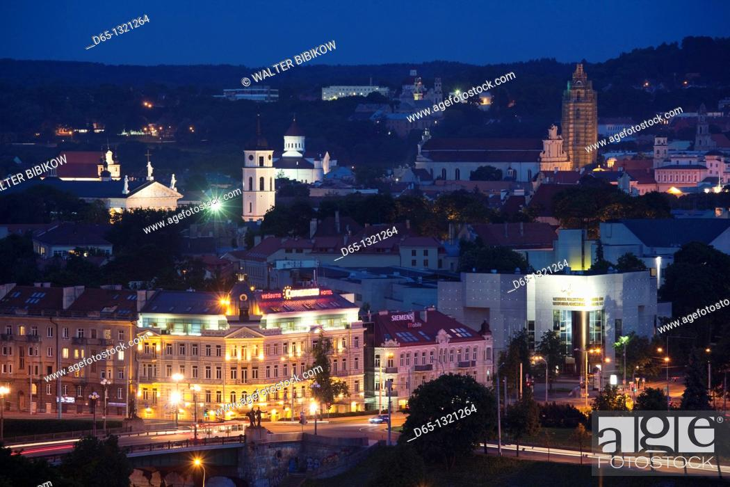 Stock Photo: Lithuania, Vilnius, elevated view of Old Town and Green Bridge, evening.