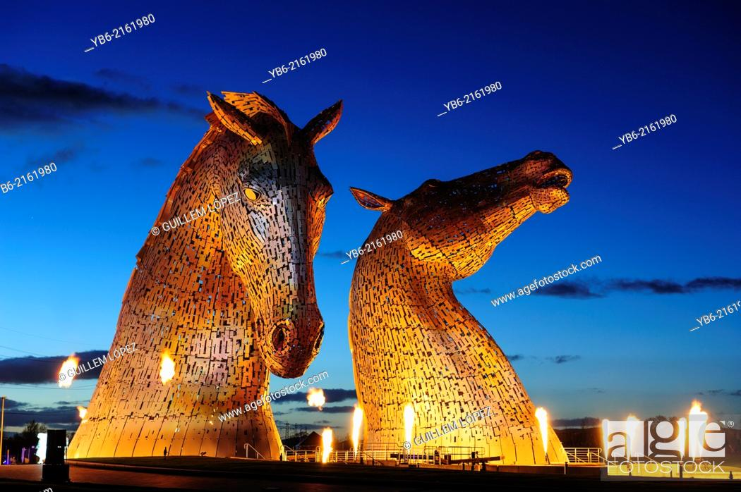 Stock Photo: The Kelpies with the light, sound and fire performance by the renowned pyrotechnic company GROUP F, The Kelpies, are a colossal 300 tonne.