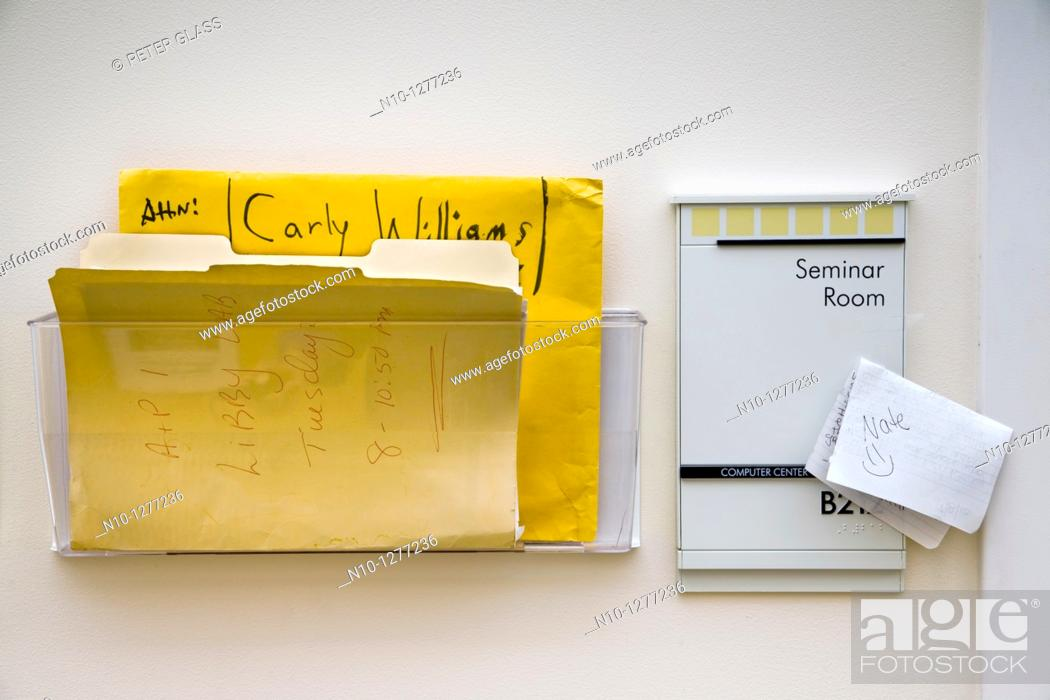 Stock Photo: Note and folders outside the door of a college professor.
