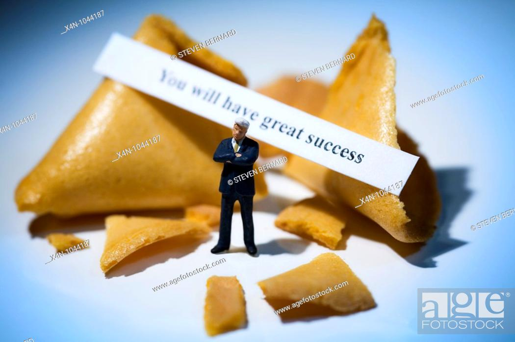 Stock Photo: Miniature businessman in front of fortune cookies with message reading you will have great success.