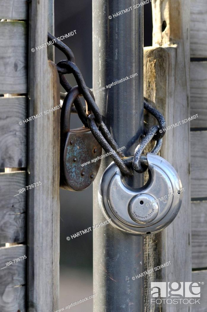 Stock Photo: Lock and chain on a gate.