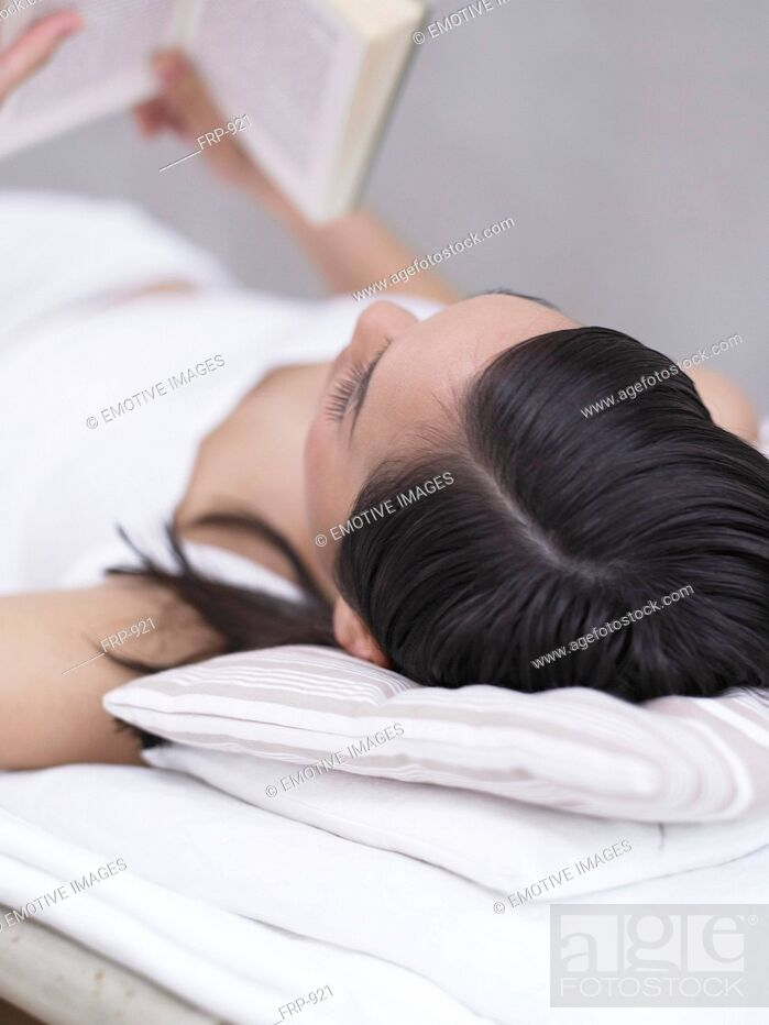 Stock Photo: Lying woman reading book.