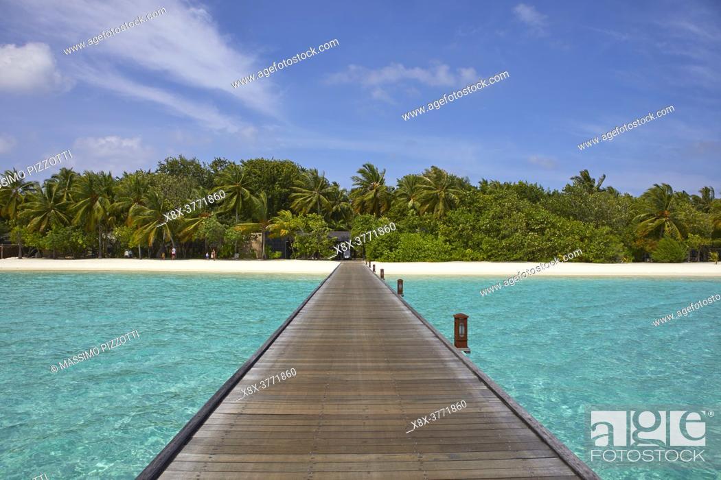 Stock Photo: Footbridge of Paradise Island (Lankanfinolhu) at sunset, Maldives.
