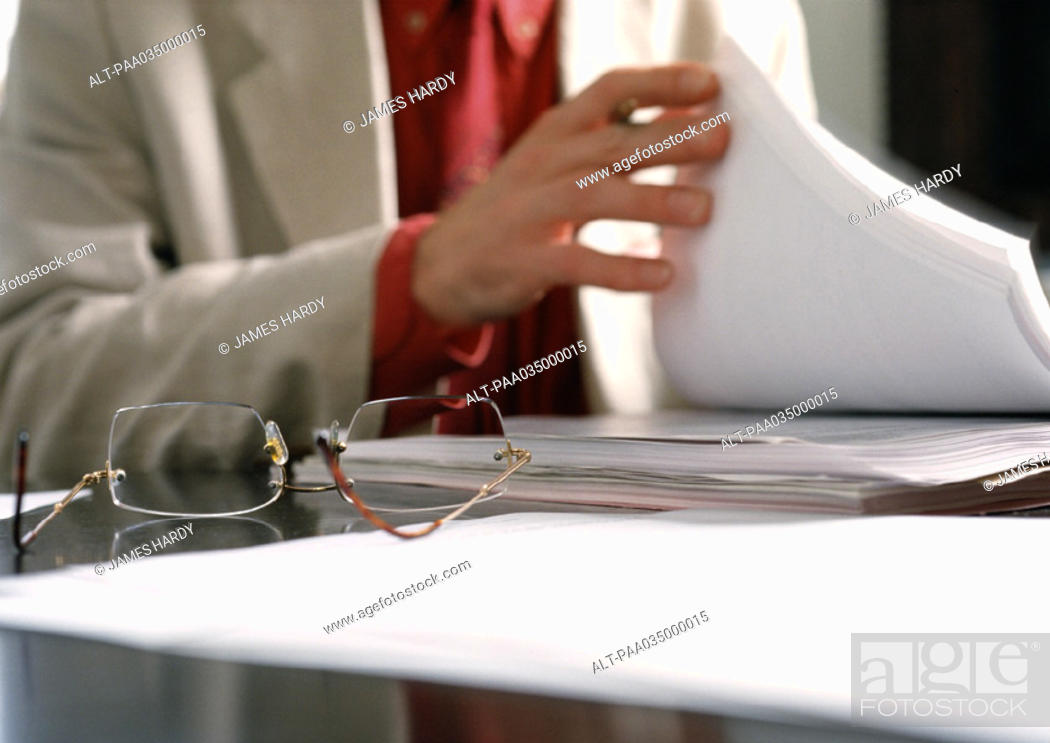Stock Photo: Person holding documents, blurred.