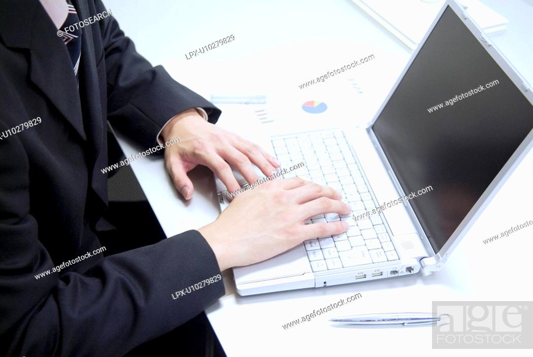 Stock Photo: The Hands Of A Businessman On A Keyboard.